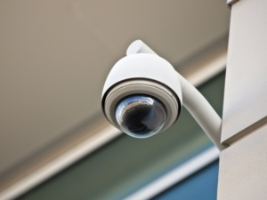 8338010 - high tech overhead security camera at a government owned building.
